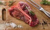Raw beef t-bone steak — Stock Photo