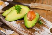 Fresh avocados on  a wooden board — Stock Photo