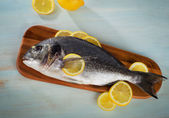 Raw sea bream with lemon — Stock Photo