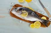 Raw sea bream with lemon — Stock Photo