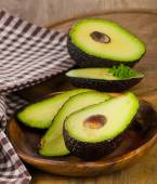 Fresh avocados on  wooden cutting board . — Stock Photo