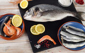 Fresh fishes  with  spices — Stock Photo