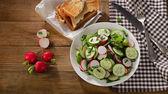 Fresh salad with radish and cucumbers .  — Stock Photo