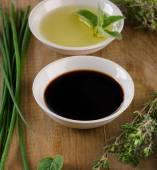 Olive oil, balsamic vinegar and herbs — Stock Photo