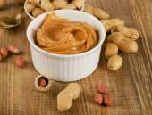 Peanut butter with peanuts — Stock Photo