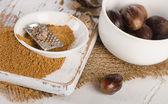 Organic ground  nutmegs — Stockfoto