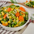 Mixed vegetables with herbs in white bowl. — Stock Photo #75574953