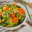 Mixed vegetables with herbs in white bowl. — Stock Photo #75574965