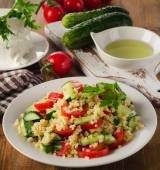 Salad with bulgur, parsley and fresh vegetables. — Stock Photo