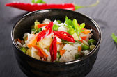 Rice and vegetables on black table — Stock Photo