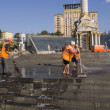 Постер, плакат: Workers hose down and clean Maidan
