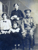 Russian Empire soldier in uniform with family — Stock Photo