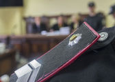Epaulettes police on Judicial board — Foto de Stock
