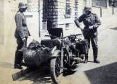 German soldiers posing on a motorcycle — Stock Photo