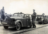 German soldiers posing near the car — Stock Photo