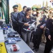 Постер, плакат: Victoria Nuland examines equipment
