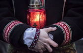 Man holding lamp — Stock Photo