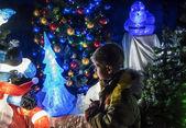 Boy and Christmas illuminations — Stock Photo