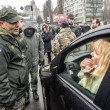 Woman in car negotiates with soldiers — Stock Photo #63683059