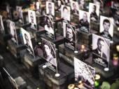 Portraits victims near chapel — Stock Photo