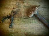 Old rusty pliers and hammer — Stock Photo