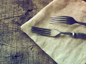 Dining forks on napkin — Stock Photo