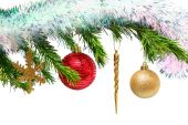 Christmas toys on fir tree twig over white — Stock Photo