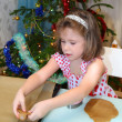Little girl baking Christmas cookies — Stock Photo #57653669