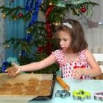 Little girl baking Christmas cookies — Stock Photo #57653695