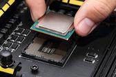 Installing central processor unit into motherboard — Foto de Stock
