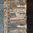 Hieroglyphic carvings in ancient egyptian temple — Stock Photo #64541273