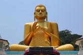 Buddha on Dambula golden temple in Sri lanka — Stock Photo