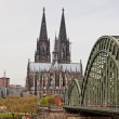 Cologne Cathedral and Hohenzollern Bridge over Rhine river — Stock Photo #68238593
