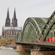 Cologne Cathedral and Hohenzollern Bridge over Rhine river — Stock Photo #68238595