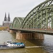 Cologne Cathedral and Hohenzollern Bridge over Rhine river — Stock Photo #68822137