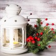 Cristmas lantern with fir and berries — Stock Photo #51808109