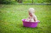 Baby in washbowl — Stock Photo