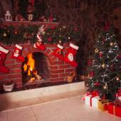 Christmas fireplace in the room — Stock Photo