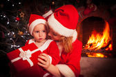 Mother and son near Christmas fireplace — Stock Photo