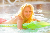 Woman swims with airbed — Stock Photo