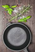 Scattered herbs and salt — Stock Photo