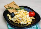 Scrambled eggs with tomato — Stock Photo