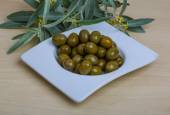 Green olives in the bowl — Stock Photo