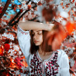 Young  woman near the tree with red leaves — Stock Photo #74146613
