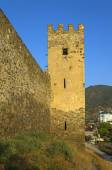 Genoese fortress in Sudak. Tower and fragment of the wall. — Stock Photo