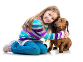 Happy little girl with her dachshund — Stock Photo