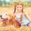 Happy little girl with her dog — Stock Photo #54525075