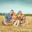 Parents and two daughters with dog — Stock Photo #54525255
