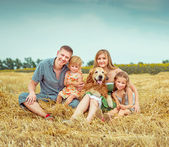 Parents and two daughters with dog — Stock Photo