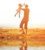 Dad playing with baby daughter — Stock Photo